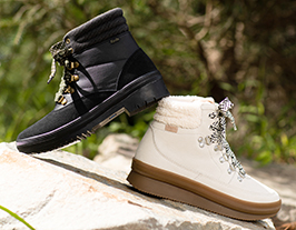Keds black and white boots on the white stone.