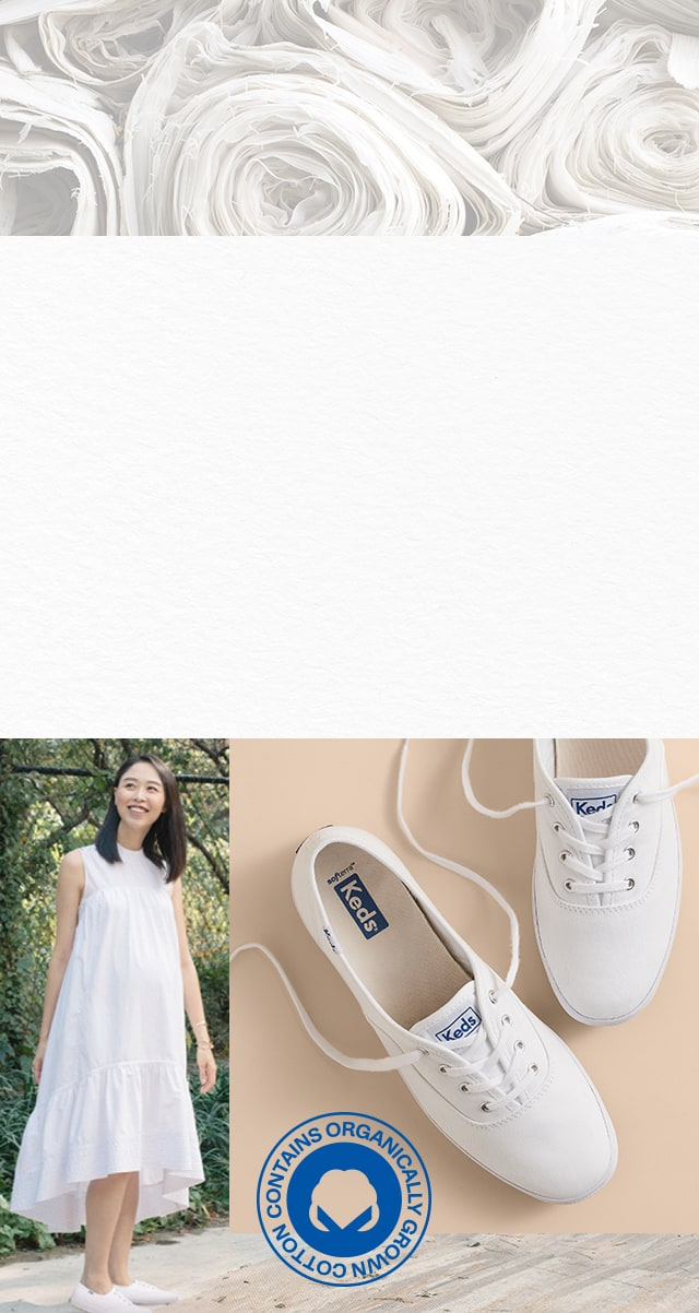 Woman in a white dress. Keds Champion sneakers in white. Rolls of organic cotton.