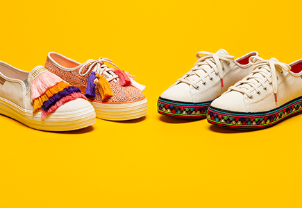 Keds with colorful, crafty accents. The style looks Incan to me, but what do I know; I'm just a web developer?