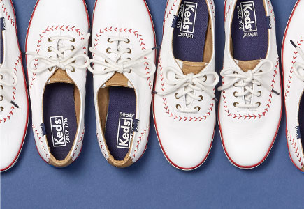 White Keds with red, baseball-style stitching.