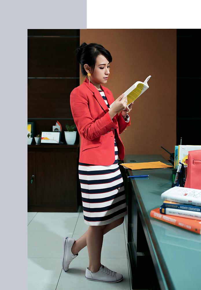 Risa Santoso reading a book