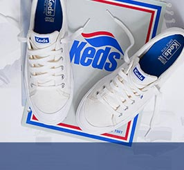 A pair of Crew Kick 75 white shoes on a Keds logo.