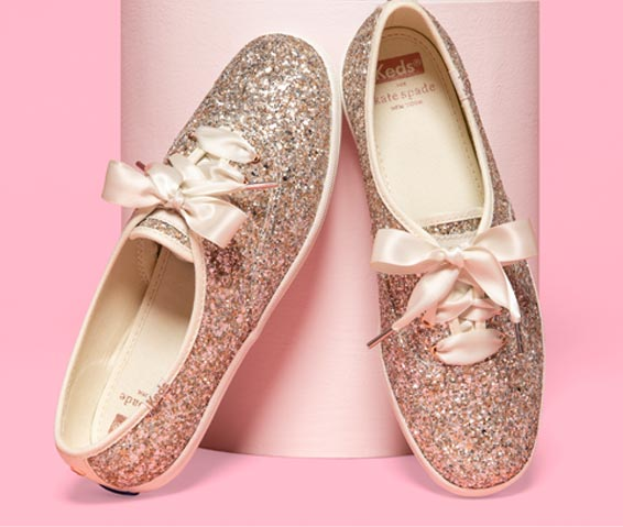 A pair of glitter shoes with thick ribbon laces.