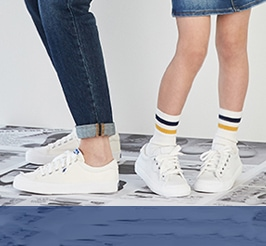 Two kids wearing Keds shoes