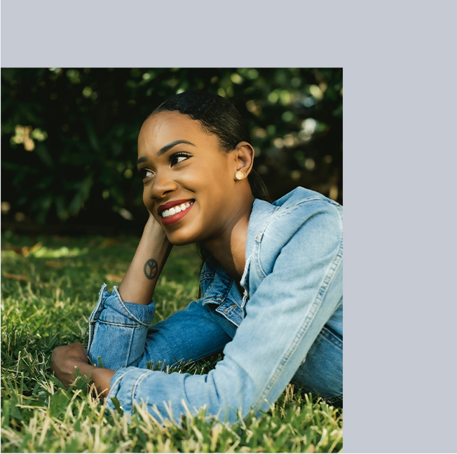 Meghan Adams lounging on grass