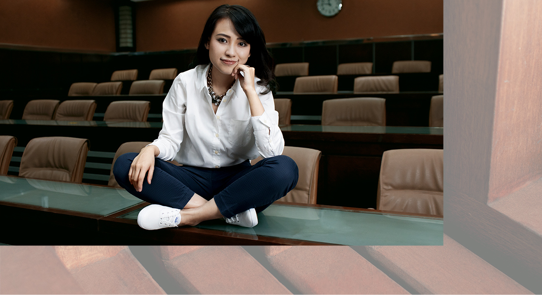 Risa sets a new standard for academic leaders in Indonesia in the white Champion sneaker