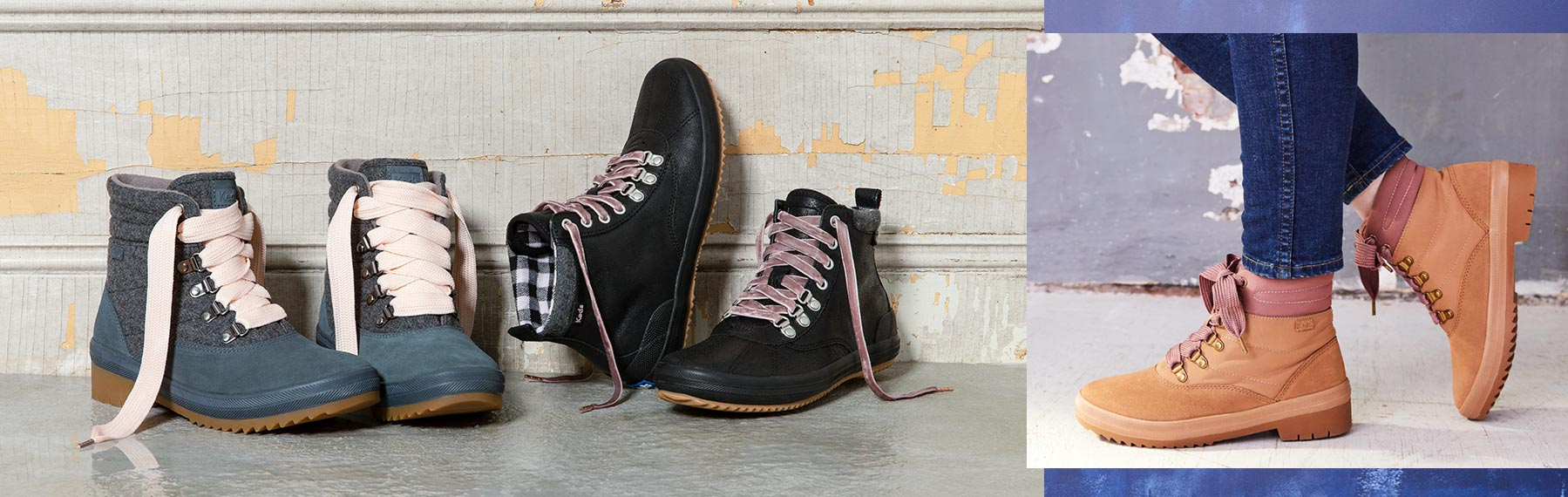 A pair of blue, black and brown boots that have the comfort of a sneaker.