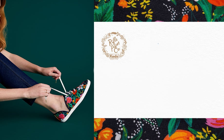 A woman lacing up her Keds x Rifle Paper Co. Vintage Champion D'Orsay Orangerie shoe.