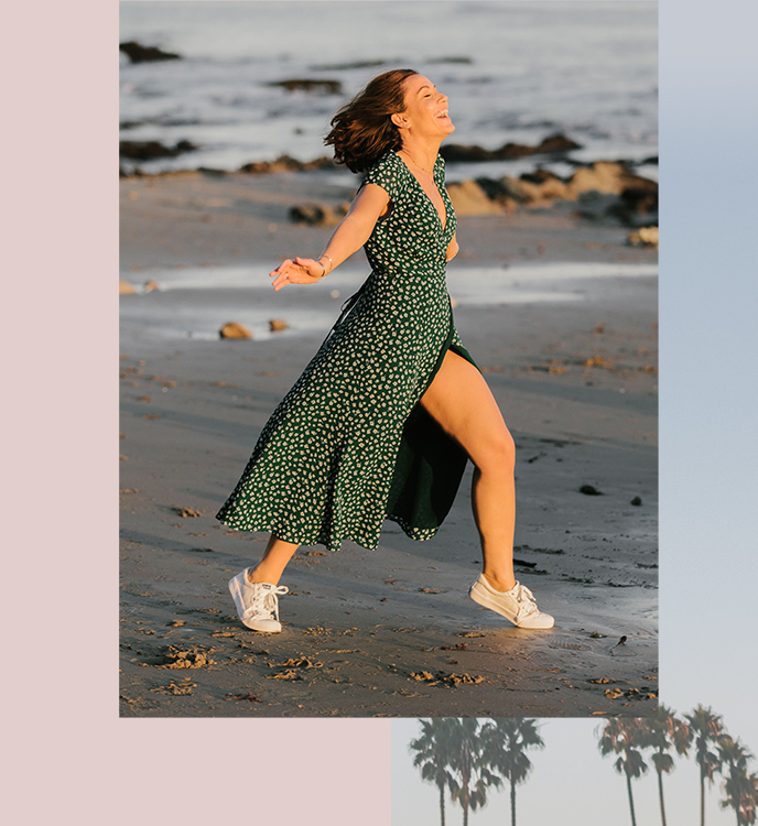 Jenna Rogers posing in the wind on a beach