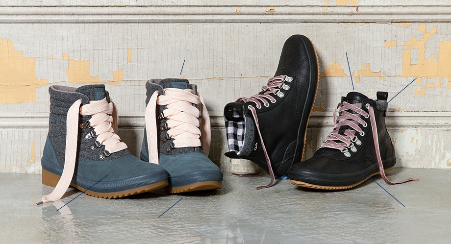 A pair of womens Camp boots in suede next to a pair of womens Scout boots in black leather