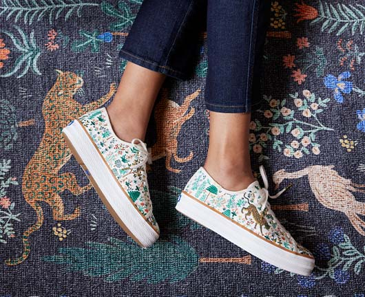 A person wearing Keds x Rifle Paper Co. Triple Kick Menagerie Embroidered shoes.
