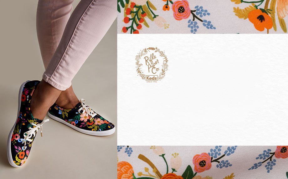 A woman wearing Keds x Rifle Paper Co. Champion Lively Floral shoes.