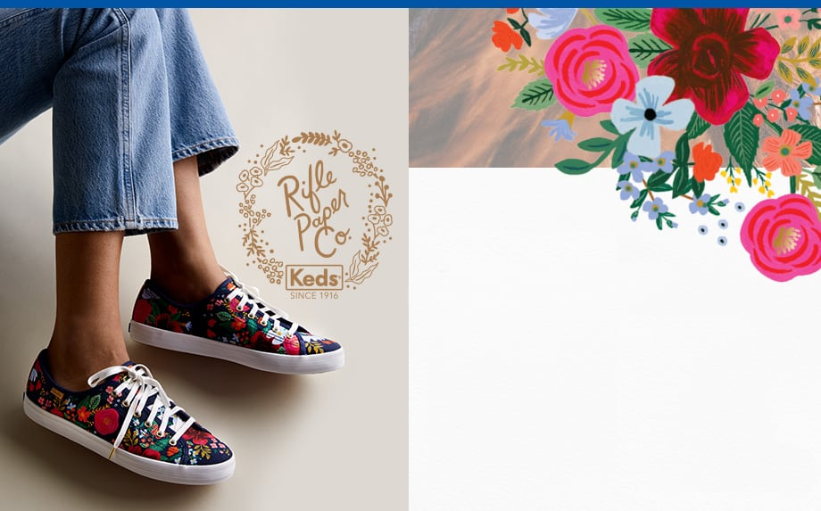 A woman wearing a pair of Keds x Rifle Paper Co. Kickstart Wild Rose shoes.